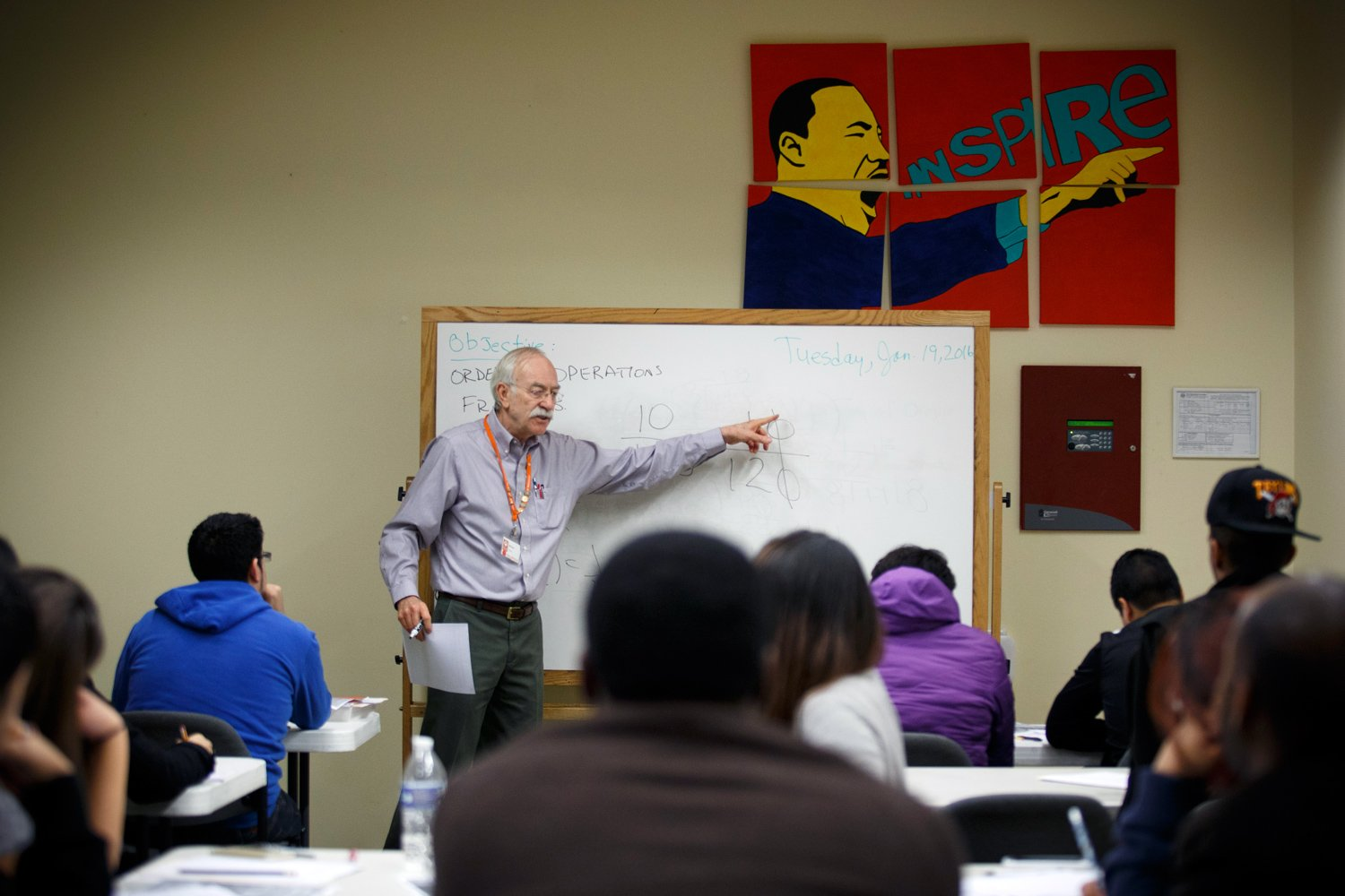 Richard Rodriguez teaches an adult math class at the Baker-Ripley  Neighborhood Center. A retired engineer, Rodriguez volunteers in the adult  education ...