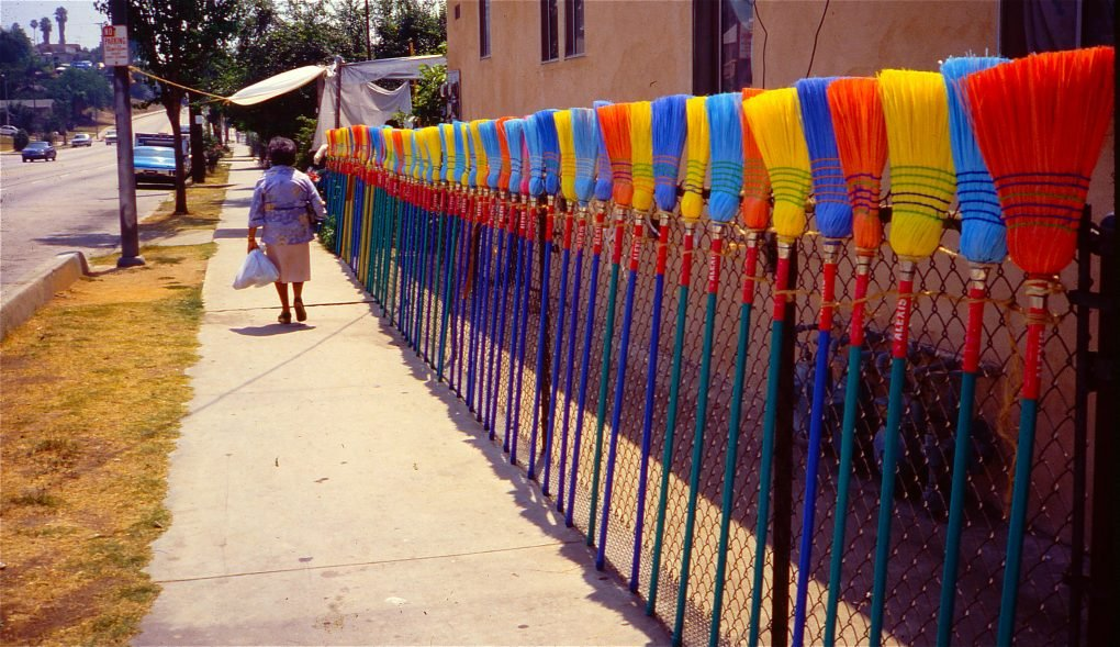 Street view with broom fence