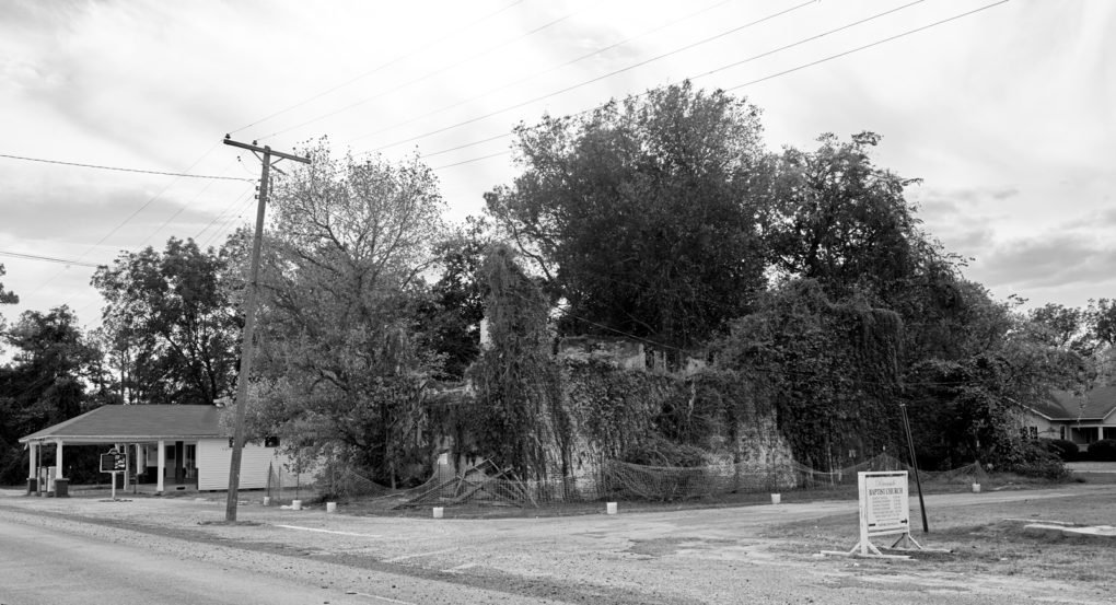 The restored Ben Roy's Service Station and the ruins of Bryant's Grocery and Meat Market, Money, Mississippi