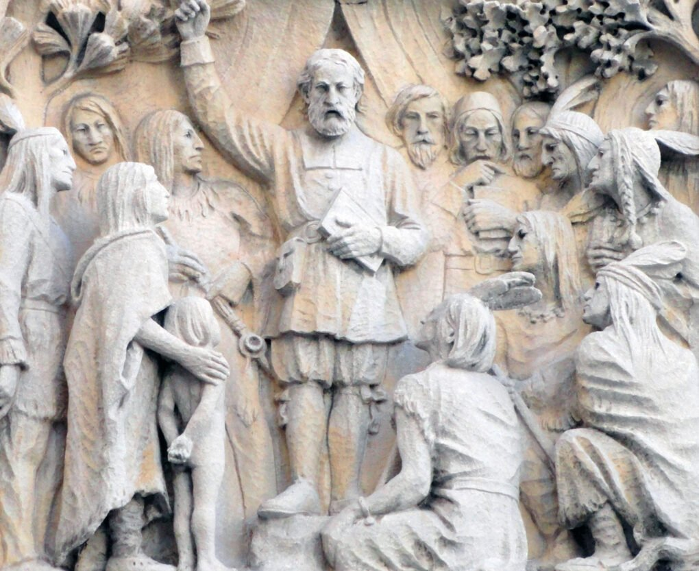 Bas relief of white colonialist preaching to Wompanoag people.