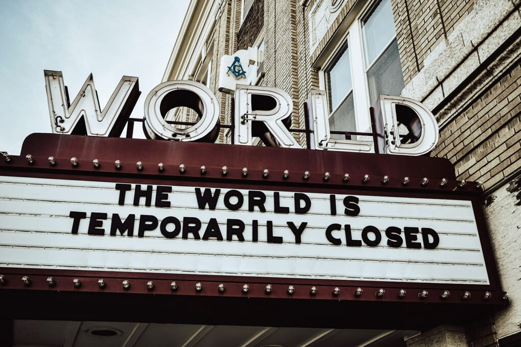 "Theater marquee, ""The world is temporarily closed"""