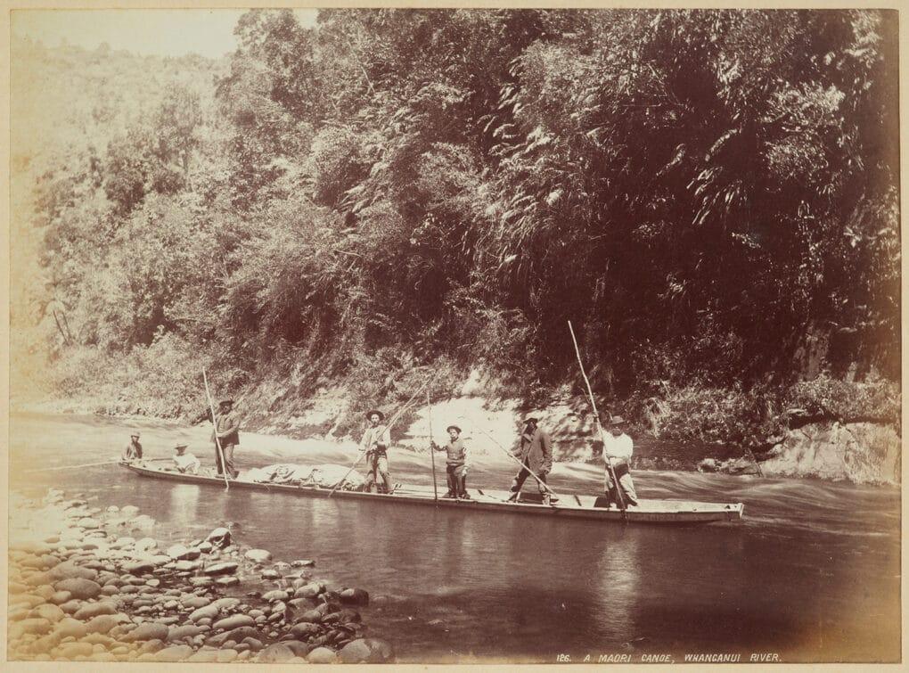 A Māori canoe on the Whanganui River, circa 1890.